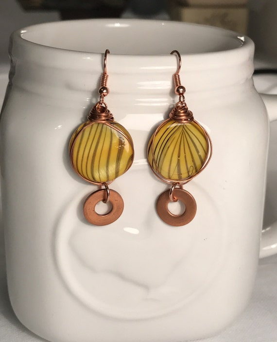 Yellow bead with copper wire wrap and dangled copper washer earrings