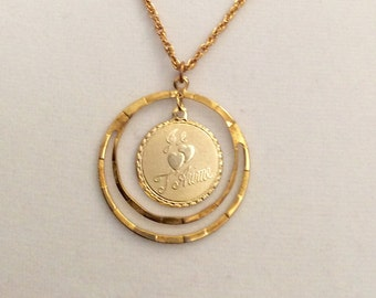 """Vintage French pendant, Je t'aime (I Love You) pendant, 3/4"""" pendant in a 1 1/4""""  hoop pendant and comes with  24"""" gold overlay chain."""