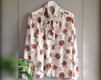 White blouse vintage blouse with tie neck designs emblazoned (40/42 - L)