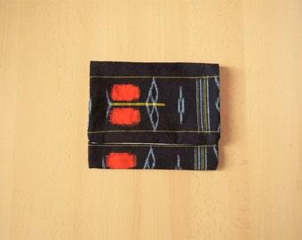 clutch in kurume-kasuri Japanese traditional weaving dark blue, red and yellow cotton