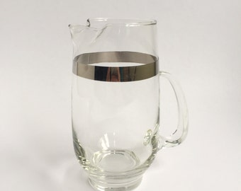 Chrome rimmed glass pitcher