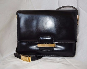 Vintage authentic Ted Lapidus genuine leather navy shoulder bag.