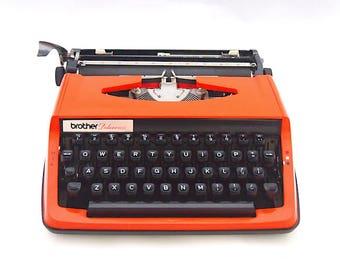 Brother Deluxe 800 typewriter, 1970s 1980s typewriter, vintage typewriter, orange typewriter, working typewriter, portable typewriter.