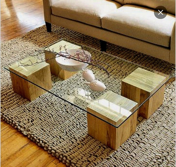 wood beam and glass coffee table.