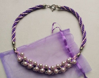 Kumihimo necklace with glass beads and decorative lock.