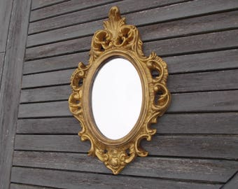 mirror of Rococo style, wood and stucco Golden Louis XV, baroque, rococo of the 70s - small oval rococo gold mirror