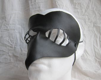 Leather mask caged heart