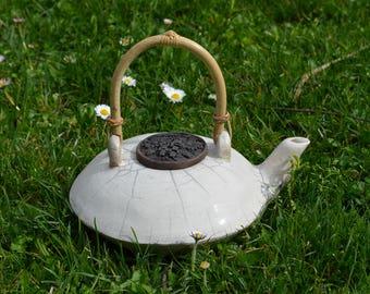 Teapots in white or copper blue raku