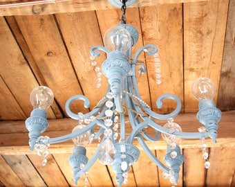 Blue chandelier - revaluation Aina