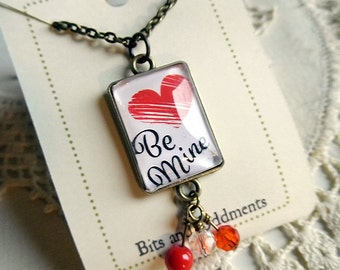 Be Mine Script necklace with playful bead tassle