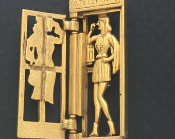 Unique vintage signed AJC superwoman telephone booth brooch