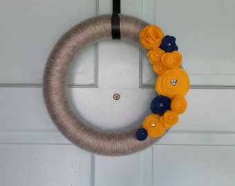 "Gray Yarn 14"" Wreath with Blue and Yellow Flowers"