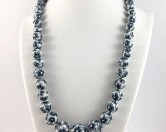 Handcrafted polymer clay necklace- indigo and white floral