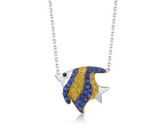 Rhodium plated Sterling Fish w/ color CZ pendant.