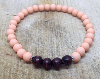 Pastel salmon pink bracelet with wooden beads