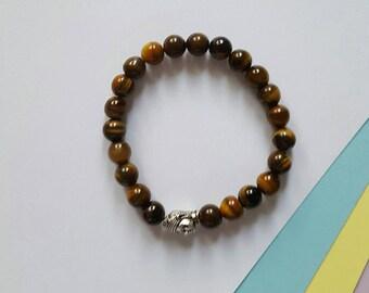 Tiger eye semi precious bracelet with Buddha charm
