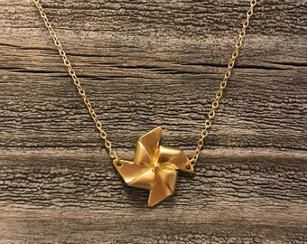 Matte gold windmill necklace