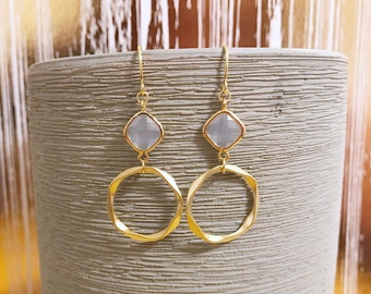 Pale blue opal earrings with a matte gold wavy hoop