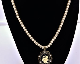 """Butterfly necklace with cream faux pearls. 20"""""""