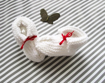 White slippers and their red ribbon