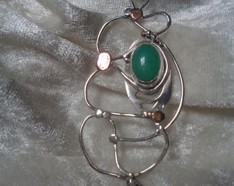 Pendant of silver and Crisopacio, with copper accents