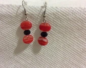 Oval flat red beads with disco ball like black bead drop earrings