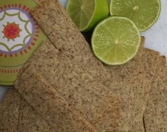 Sumac & Lime Crackers with optional metal canister. Subtly tangy, unusual, delicious. Ideal for mild spread cheese or cold meats.