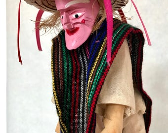 Folk art figurine. Mexican folk art. Folk dancer. Hand-carved figurine. Textile art.