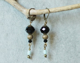 Black and bronze earrings at Blue charms