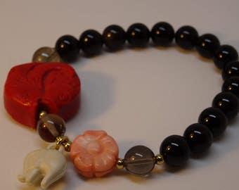 Bracelet Onyx with fish