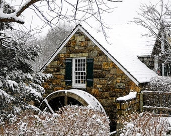 A working old grist mill in a winter setting