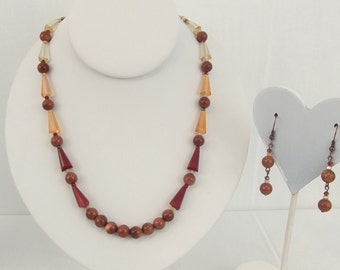 Sparkly copper tone and orange necklace with matching earrings