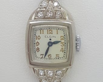A vintage Elgin 14k white gold ladies watch with diamonds