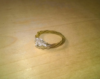 Ring from a guitar string made with silver wire-wound