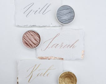 Metallic ink and leaf place cards on hand made paper - gold, silver, rose gold