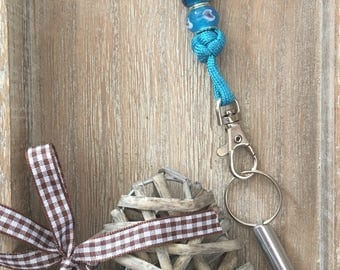 Dog whistle to parachute cord chain