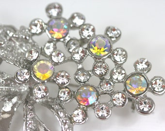 Silver-tone bouquet brooch with sparkling rainbow and clear rhinestones - vintage