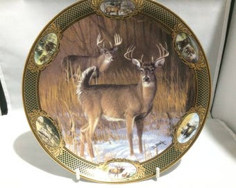 Franklin Mint collectors plate , 10 point buck , limited edition , porcelain , gilding on and around the plate ,