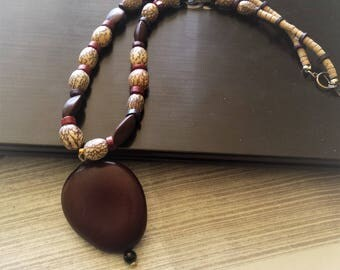 Ethnic necklace in natural seeds with pendant for men