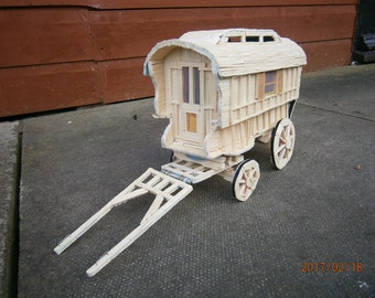 This is a Ledge style caravan made out of matchsticks and was common many years ago on circus and fair show grounds
