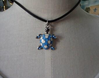 Turtle necklace.