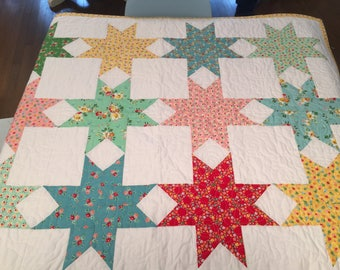 Patchwork Star Quilt made with Backyard Roses fabric by Dalgleish Clothworks