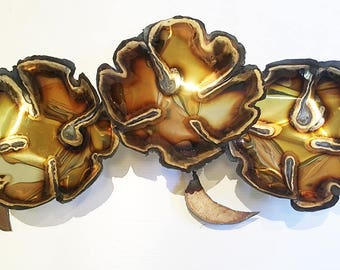 """The """"Three Rhododendrons"""" Brass Wall Sculpture adds luster to you office or home."""