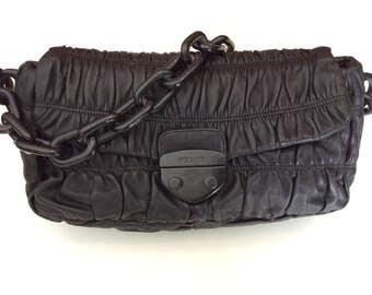Black gaufre leather handbag by Prada, pleated lambskin