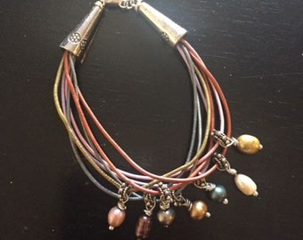 Southwestern influenced leather bracelet with pearls