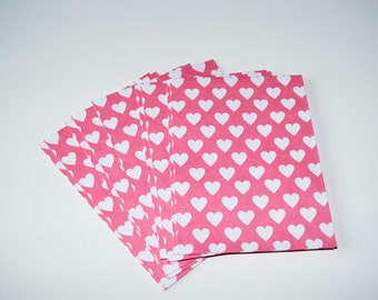 Set of 10 design envelopes, pink with white hearts and blue/green with white hexagons