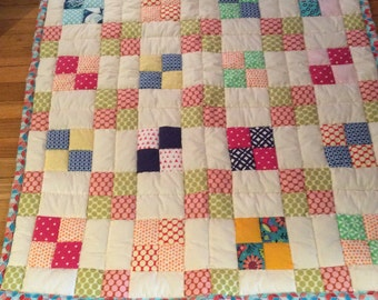 Non-traditional retro design hand-stitched quilt