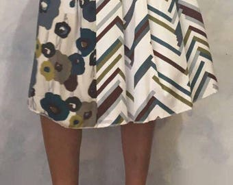 White skirt with floral design  and stripes