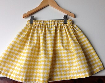 Girl in cotton print vague yellow skirt