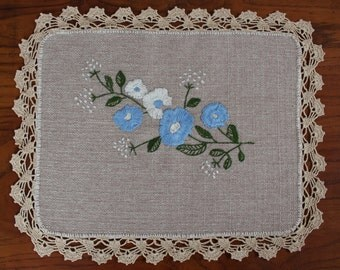 Handmade embroidered tablecloth with lace edges